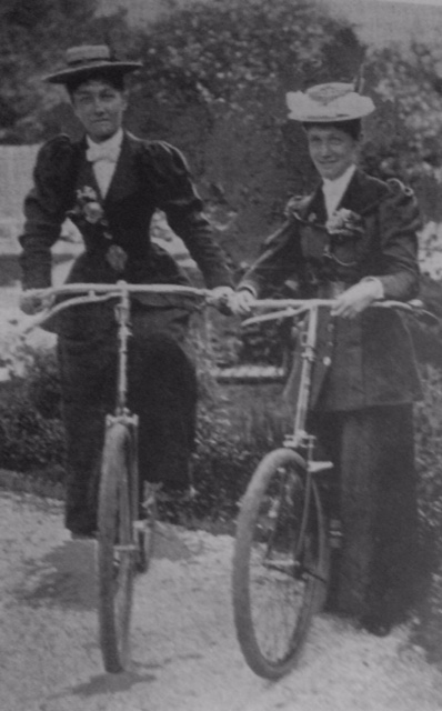 Two female cyclists dressed in typical cycling outfit in the 1890s